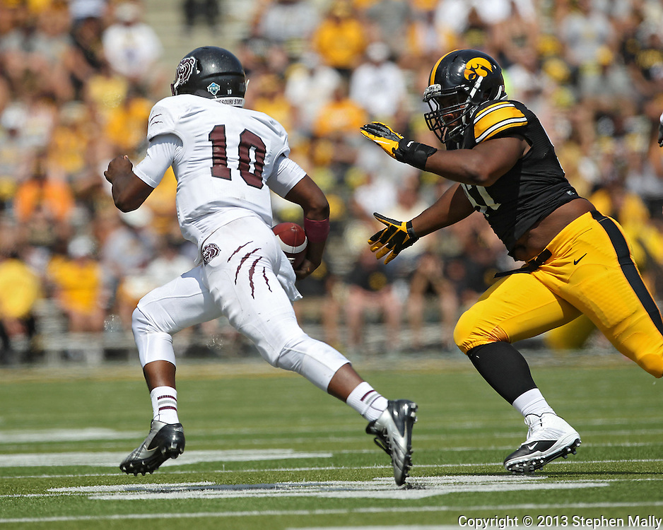 September 07 2013: Iowa Hawkeyes defensive lineman Darian Cooper (97) tries to run down Missouri State Bears quarterback Kierra Harris (10) during the third quarter of the NCAA football game between the Missouri State Bears and the Iowa Hawkeyes at Kinnick Stadium in Iowa City, Iowa on September 7, 2013. Iowa defeated Missouri State 28-14.