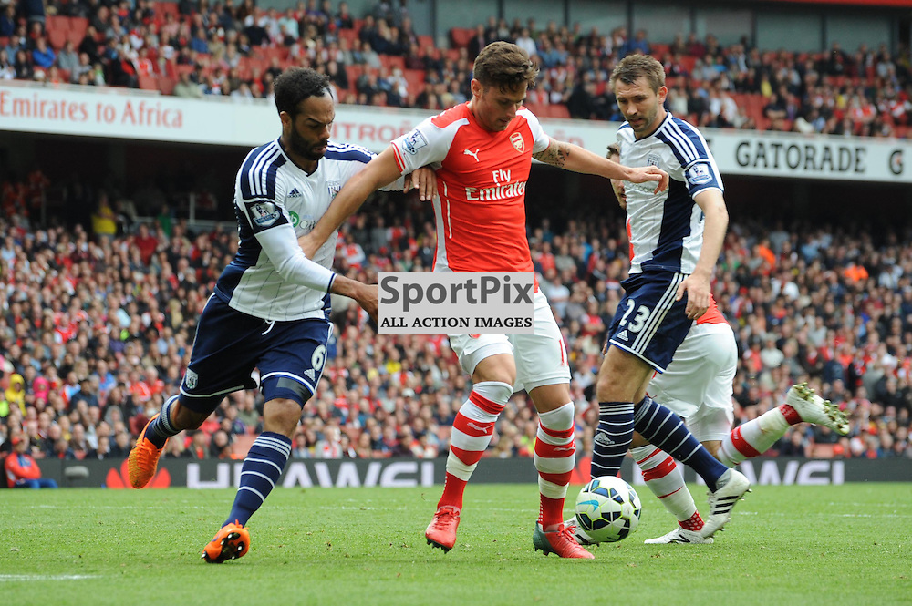 Arsenals Oliver Giroud and West Broms Joleon Lescott and Gareth McAuley in action during the Arsenal v West Brom match on Sunday 24th May 2015