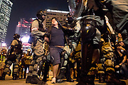 HONG KONG: 14 October 2019 <br /> A man is arrested in the Central area of Hong Kong this evening as demonstrators move into their 19th consecutive week of protests. The movement's aim, which started on June 1st, originally wanted to get rid of a controversial extradition bill which has since been removed, however the protests have formed into a wider fight against police brutality and the ability to wear a mask without fear of arrest.<br /> Rick Findler / Story Picture Agency
