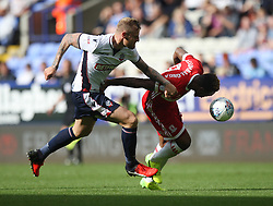 David Wheater of Bolton Wanderers (L) and Britt Assombalonga of Middlesbrough in action - Mandatory by-line: Jack Phillips/JMP - 09/09/2017 - FOOTBALL - Macron Stadium - Bolton, England - Bolton Wanderers v Middlesbrough - English Football League Championship