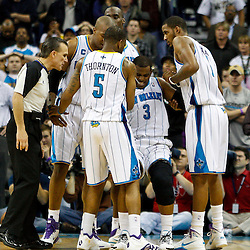 January 24,  2011; New Orleans, LA, USA; New Orleans Hornets point guard Chris Paul (3) is helped to his feet by teammates after twisting his left ankle during the final minute of a win over the Oklahoma City Thunder at the New Orleans Arena. The Hornets defeated the Thunder 91-89. Mandatory Credit: Derick E. Hingle