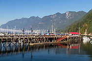 The Horseshoe Bay Public Dock at Horseshoe Bay, British Columbia, Canada. Howe Sound and Saint Mark's Summit, Unnecessary Mountain, Mount Harvey, Brunswick Mountain (of the  Pacific Ranges and Coast Mountains) are in the background.