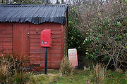 Closed for winter tourist shed and post box at Lochbuie, Isle of Mull, Scotland.