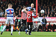 Brentford defender Henrik Dalsgaard (22) and Queens Park Rangers defender Toni Leistner (37) *** during the EFL Sky Bet Championship match between Brentford and Queens Park Rangers at Griffin Park, London, England on 2 March 2019.