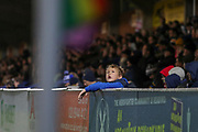 Young AFC Wimbledon fan looking up during the EFL Sky Bet League 1 match between AFC Wimbledon and Gillingham at the Cherry Red Records Stadium, Kingston, England on 23 November 2019.