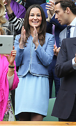 Pippa Middleton applauds Roger Federer from the Royal Box in Centre Court after he won his first match on the opening day of Wimbledon 2013<br /> London, Monday, 24th June 2013<br /> Picture by Stephen Lock / i-Images