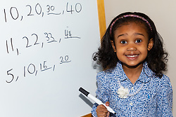 Already adept at arithmetic and number sequences, four-year-old Alannah George who has an IQ of 140 and taught herself to read at two-and-a-half, is a member of Mensa. Iver, Buckinghamshire, March 10 2019.