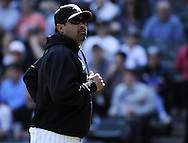 CHICAGO - JUNE 12:  Manager Ozzie Guillen #13 of the Chicago White Sox looks on after making a pitching change against the Oakland Athletics on June 12, 2011 at U.S. Cellular Field in Chicago, Illinois.  The White Sox defeated the Athletics 5-4.  (Photo by Ron Vesely)   Subject:  Ozzie Guillen