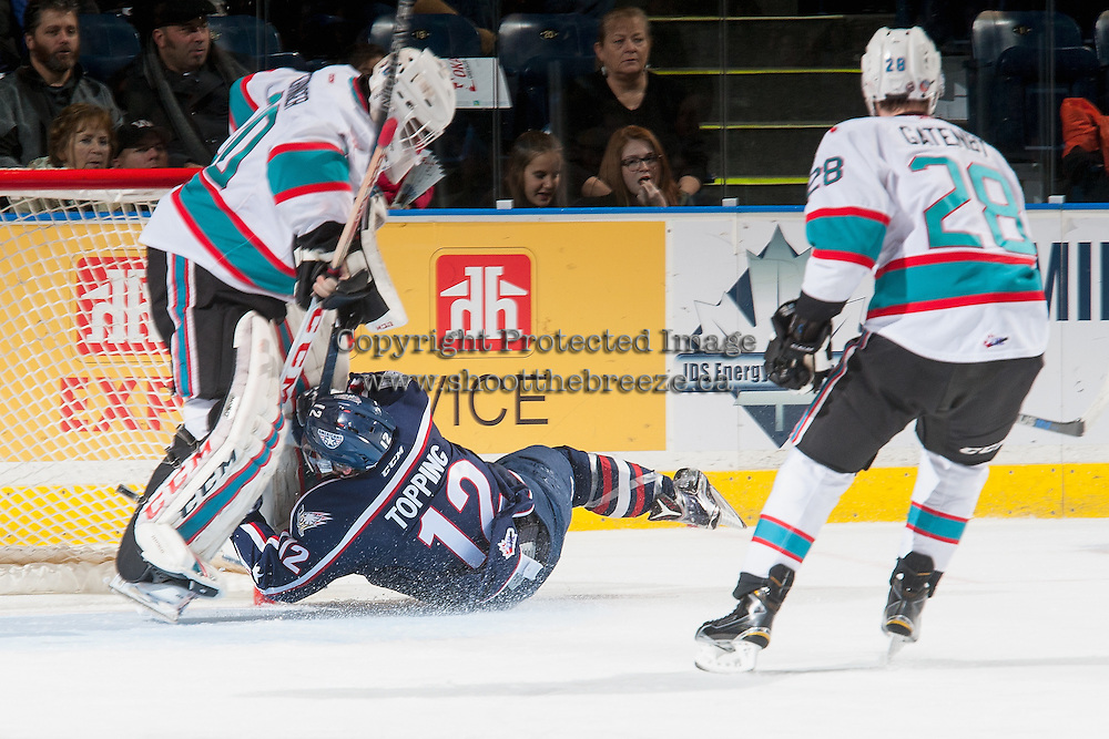 KELOWNA, CANADA - JANUARY 9: Jordan Topping #12 of Tri City Americans collides with Michael Herringer #30 of Kelowna Rockets in the second period on January 9, 2016 at Prospera Place in Kelowna, British Columbia, Canada.  (Photo by Marissa Baecker/Shoot the Breeze)  *** Local Caption *** Michael Herringer; Jordan Topping;