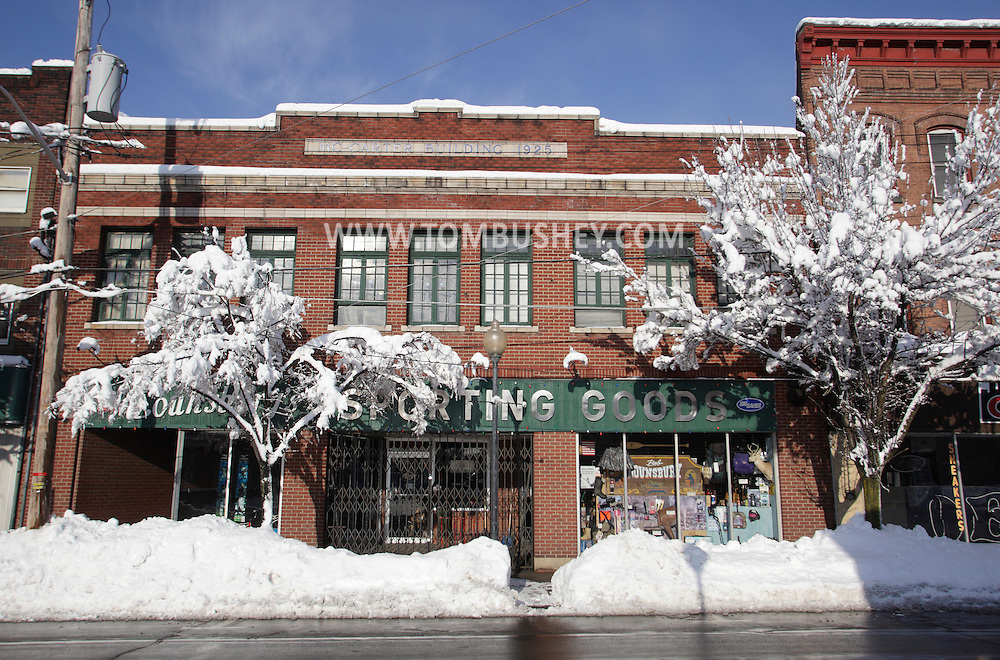 Middletown, New York - Snow covered the trees and is piled up by the street in front of a store after a storm dropped about two feet of snow on the city on Feb. 27, 2010.