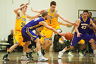 Catamounts forward Zach McRoberts (1) kicks the pass by Great Danes forward Dallas Ennema (24) during the men's basketball game between the Albany Great Danes and the Vermont Catamounts at Patrick Gym on Wednesday night January 28, 2015 in Burlington, Vermont. (BRIAN JENKINS, for the Free Press)