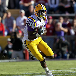 November 6, 2010; Baton Rouge, LA, USA; LSU Tigers wide receiver Terrence Toliver (80) runs after a catch during the first half against the Alabama Crimson Tide at Tiger Stadium. LSU defeated Alabama 24-21.  Mandatory Credit: Derick E. Hingle