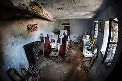 Interior of a troglodyte dwelling in the village of Graufthal, Alsace, France.  The houses are built into the cliffs with the rock forming the ceiling and floor.  Dating back several centuries, the houses were inhabited until 1958 and are now a historical monument.<br /> <br /> (c) Andrew Wilson | Edinburgh Elite media