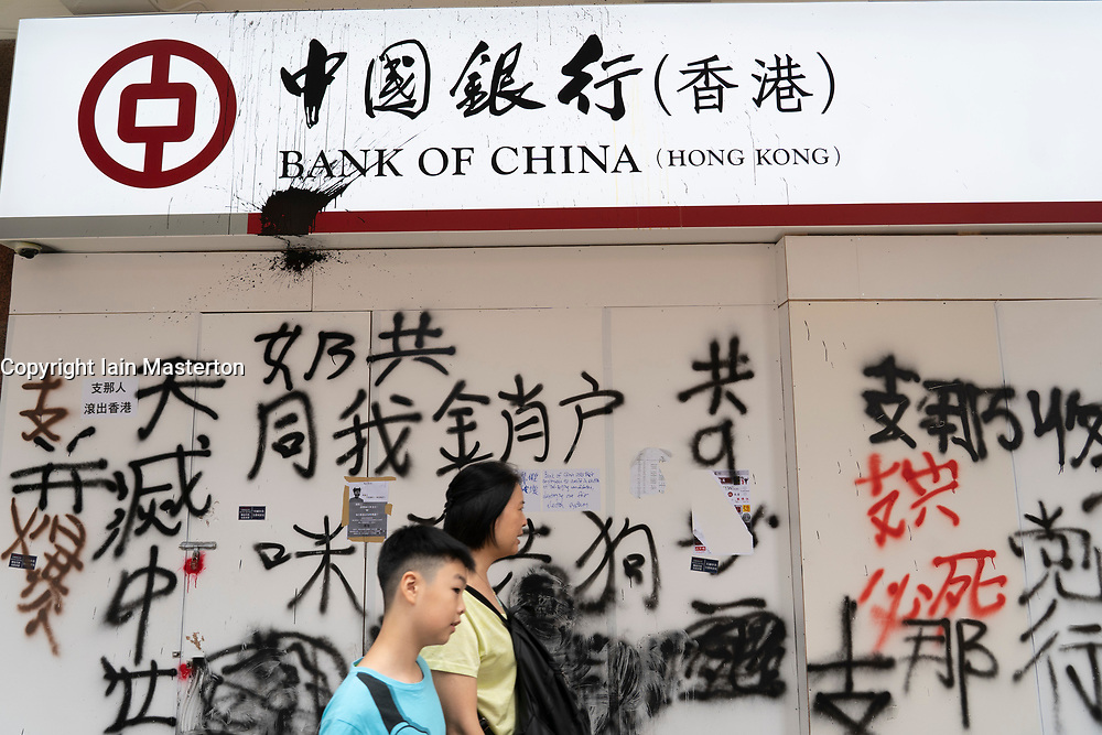 Kowloon, Hong Kong, China,. 7 October, 2019. After a night of violent confrontations between police and pro-democracy protestors in MongKok and YauMaTei in Kowloon, many MTR railway stations and what are thought to be pro-Beijing business franchises were vandalised. Vandalised Bank of China branch .