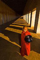 Novice monk holding an alms bowl, Shwezigon Pagoda, Bagan, Myanmar (Burma)
