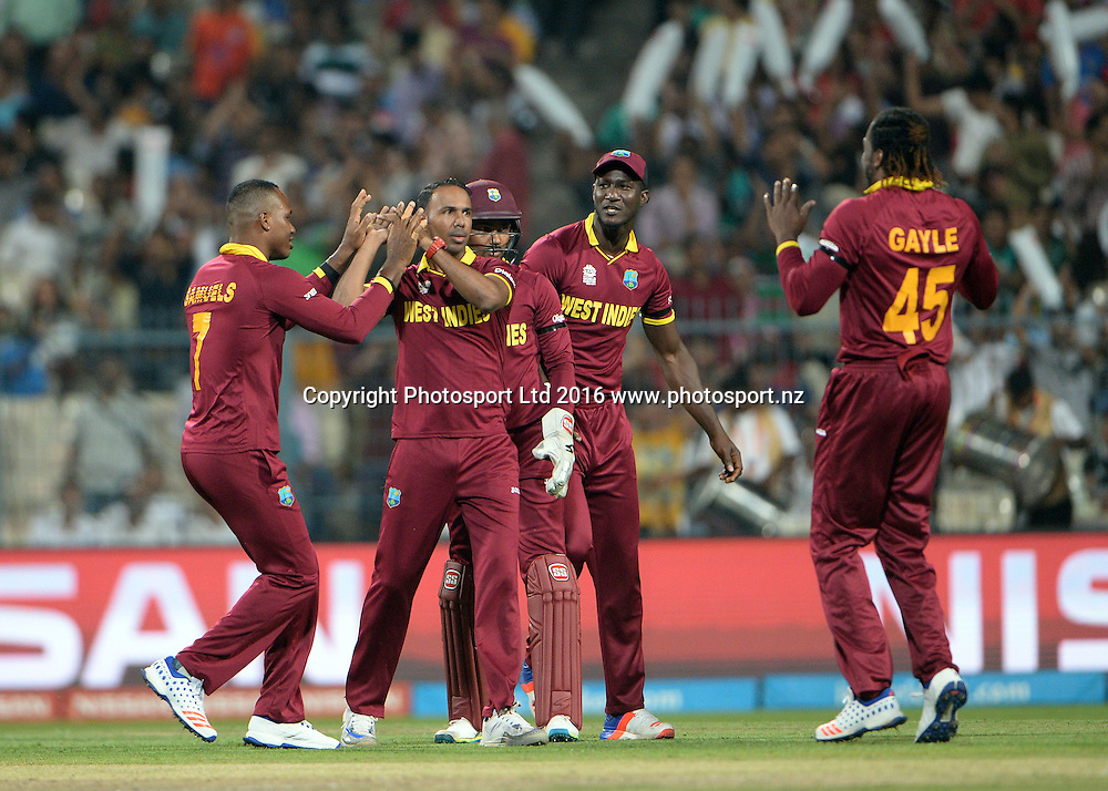West Indies player Samuel Badree celebrates with his team the wicket of England player Jason Roy during the ICC Twenty20 World Cup final match between England and West Indies at the Eden Garden Stadium in Kolkata, India on April 3, 2016.<br /> West Indies win by 4 wickets.<br /> Copyright photo: Narender Kumar / www.photosport.nz
