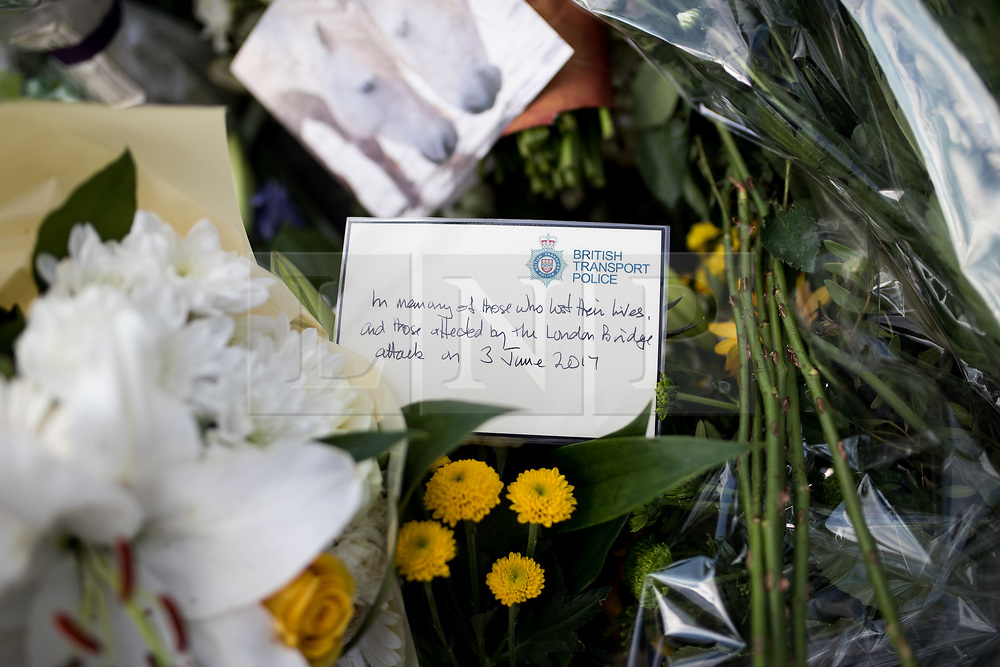 © Licensed to London News Pictures. 03/06/2018. London, UK. A note left on flowers from the staff of British Transport Police, marking one year since the London Bridge and Borough Market terror attacks. A series of events have taken place throughout the day, including a service of commemoration at Southwark Cathedral, the planting of an olive tree in the Cathedral grounds, a minute's silence at 4:30pm and the laying of flowers.  Photo credit : Tom Nicholson/LNP