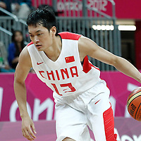 31 July 2012: China Jianghua Chen dribbles during the 73-54 Russia victory over China, during the men's basketball preliminary, at the Basketball Arena, in London, Great Britain.