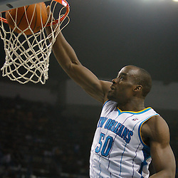 January 17, 2011; New Orleans, LA, USA; New Orleans Hornets center Emeka Okafor (50) dunks against the Toronto Raptors during the second quarter at the New Orleans Arena.   Mandatory Credit: Derick E. Hingle