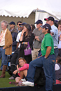 Prince Harry and friends watching Polo. Cartier International Day at Guards Polo Club, Windsor Great Park. July 24, 2005. ONE TIME USE ONLY - DO NOT ARCHIVE  © Copyright Photograph by Dafydd Jones 66 Stockwell Park Rd. London SW9 0DA Tel 020 7733 0108 www.dafjones.com