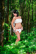 innocent female angel in a forest