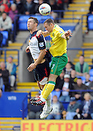 Picture by Chris Donnelly/Focus Images Ltd. 07500 903009 .17/9/11.Gary Cahill of Bolton and Andrew Crofts of Norwich clash during the Barclays Premier League match at Reebok stadium, Bolton.