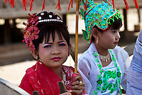 Two little girls dressed in traditional costumes for a ceremony, Myanmar. Exotic people wall art. Fine art photography prints for sale, stock images