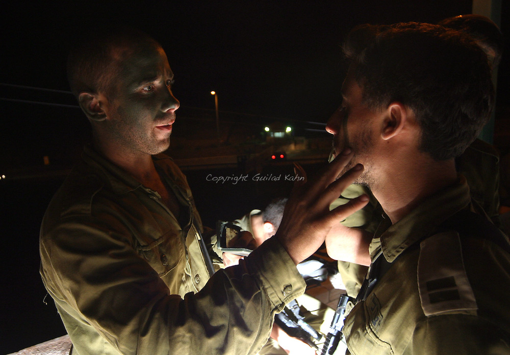 Paratroopers on the northern Israeli border get ready to enter Lebanon on a night mission into the village of Taybeh in southern Lebanon on Tuesday August 1st 2006..