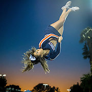 An Organge Coast College cheerleader practices during warm up at a football game between Orange Coast  College and Golden West College at LeBard stadium in Costa Mesa, CA on Saturday, November 8 2015. (Dotan Saguy / SSA)