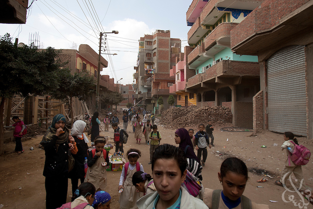 Egyptian schoolchildren return home after their day classes October 27, 2011  in the village of Warwara, outside the Delta city of Benha, and about 50 kilometers north of Cairo. (Photo by Scott Nelson)