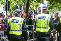 London, June 24th 2017. Anti-fascist protesters counter demonstrate against a march to Parliament by the far right anti-Islamist English Defence League. PICTURED: Police keep watch over anti-fascists following a scuffle near Trafalgar Square.