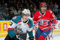 KELOWNA, CANADA - MARCH 5: Justin Kirkland #23 of the Kelowna Rockets is checked by a player of the Spokane Chiefs during the third period on March 5, 2014 at Prospera Place in Kelowna, British Columbia, Canada.   (Photo by Marissa Baecker/Getty Images)  *** Local Caption *** Justin Kirkland;