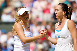 LONDON, ENGLAND - Saturday, June 28, 2008: Caroline Wozniacki (DEN) shakes hands with Jelena Jankovic (SRB) after her third round defeat on day six of the Wimbledon Lawn Tennis Championships at the All England Lawn Tennis and Croquet Club. (Photo by David Rawcliffe/Propaganda)