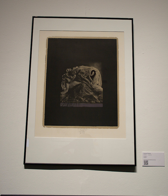 Gorazd Sefran   <br /> Slovenian (Ljubljana, 1945)<br /> &ldquo;Caught 11&rdquo;<br /> lithograph<br /> <br /> Gorazd Sefran is a painter and printmaker who employs and manipulates photography in his work.  He studied in Ljubljana before completing graduate work in Nuremburg.  Sefran&rsquo;s enigmatic images derive from the graveyard near his childhood home, where he would see the accumulation of forgotten casket covers, shovels, work gloves, and dessicated bouquets. Suspended in a dark nowhere, the pile of these objects become a fleeting memento mori.<br /> <br /> <br /> http://www.memphis.edu/amum/exhibitions/gorazd.sefran.php