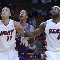17 November 2010: Phoenix Suns' center #8 Channing Frye vies with Miami Heat's center #11 Zydrunas Ilgauskas and Miami Heat's small forward #6 LeBron James during the Miami Heat 123-96 victory over the Phoenix Suns at the AmericanAirlines Arena, Miami, Florida, USA.