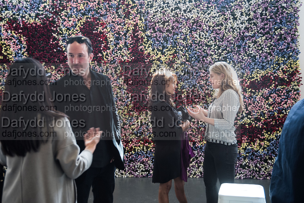 PETROC SESTI; MICHAELA D' SOUZA, PHILLY ADAMS, In front of Ebola Roses by Michael Pinsky, Opening of ART15, Olympia, London. 20 May 2015