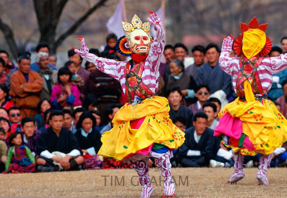 Masked dancers perform Skeleton Dance, Paro, Bhutan