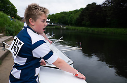 © Licensed to London News Pictures.13/06/15<br /> Durham, England<br /> <br /> A young rower prepares to lower his boat into the river during the 182nd Durham Regatta rowing event held on the River Wear. The origins of the regatta date back  to commemorations marking victory at the Battle of Waterloo in 1815. This is the second oldest event of this type in the country and attracts over 2000 competitors from across the country.<br /> <br /> Photo credit : Ian Forsyth/LNP