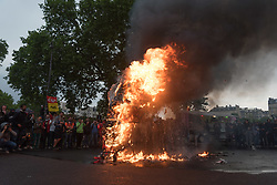 Around 15,000 civil servants demonstrated in Paris at the call of the main trade unions to defend their status and oppose the next reform wanted by the government. The demonstrators burned a representation of President Emmanuel Macron's head. Paris, France, May 22, 2018. Photo by Samuel Boivin / ABACAPRESS.COM