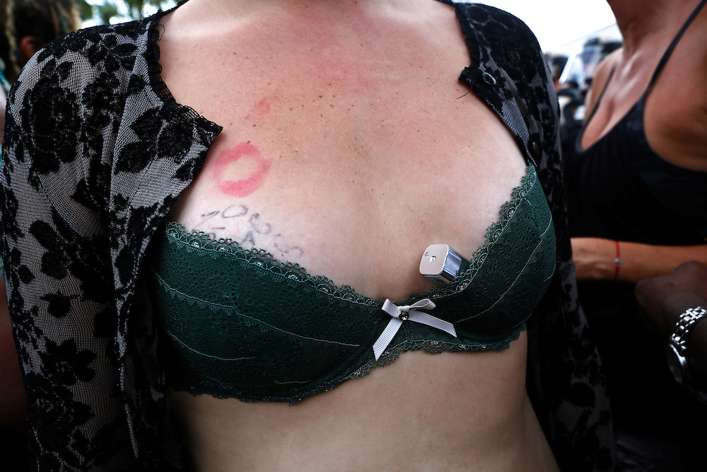 A protester carries her lipstick in her bra as she marches through the streets of Tampa during the 2012 Republican National Convention on August 28, 2012 in Tampa, Fla.