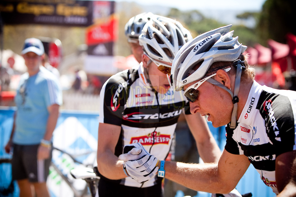 Riders congratulate eachother at the finish of the Prologue of the 2011 Absa Cape Epic Mountain Bike stage race held at the Chrysalis Academy in Tokai Forest outside Cape Town, South Africa on the 27 March 2011..Photo by Karin Schermbrucker/Cape Epic/SPORTZPICS