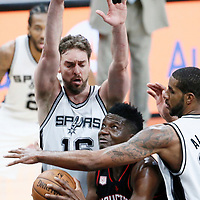 03 May 2017: Houston Rockets center Clint Capela (15) drives past San Antonio Spurs forward LaMarcus Aldridge (12) and San Antonio Spurs center Pau Gasol (16)  during the San Antonio Spurs 121-96 victory over the Houston Rockets, in game 2 of the Western Conference Semi Finals, at the AT&T Center, San Antonio, Texas, USA.