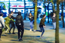 © Licensed to London News Pictures . 07/04/2017 . Manchester , UK . 1st in a sequence . A fight breaks out in Piccadilly Gardens . Greater Manchester Police have authorised dispersal powers and say they will ban people from the city centre for 48 hours , this evening (7th April 2017) , in order to tackle alcohol and spice abuse . Photo credit : Joel Goodman/LNP