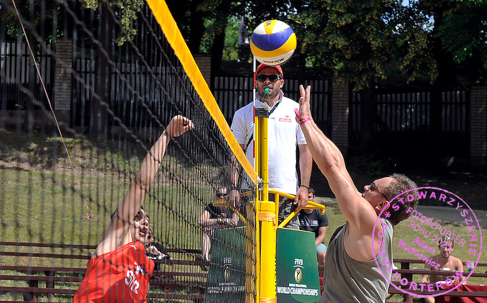 (R) Cezary Pazura famous polish actor while training session match of Special Olympics Poland during Day 7 of the FIVB World Championships on July 7, 2013 in Stare Jablonki, Poland. <br /> <br /> Poland, Stare Jablonki, July 07, 2013<br /> <br /> Picture also available in RAW (NEF) or TIFF format on special request.<br /> <br /> For editorial use only. Any commercial or promotional use requires permission.<br /> <br /> Mandatory credit:<br /> Photo by &copy; Adam Nurkiewicz / Mediasport
