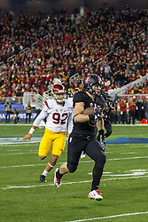 SANTA CLARA, CA - DECEMBER 05:  Running back Christian McCaffrey #5 of the Stanford Cardinal returns a punt against the USC Trojans during the second quarter of the Pac-12 Championship game at Levi's Stadium on December 5, 2015 in Santa Clara, California. The Stanford Cardinal defeated the USC Trojans 41-22. (Photo by Jason O. Watson/Getty Images) *** Local Caption *** Christian McCaffrey