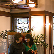 The National Park Service announced the Robie House, the 1910 masterpiece by architect Frank Lloyd Wright built in his classic Prairie Style, has been submitted to UNESCO for World Heritage nomination. Wright built the house for Frederick C. Robie on the campus of the University of Chicago in the neighborhood of Hyde Park in Chicago. Siomara Rodriguez and friend Albert Brown listen to live music by guitarist David Saenger. <br /> Photography by Jose More