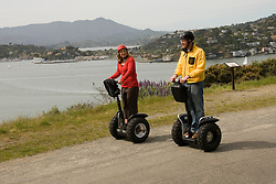 Couple on Segways, each on a Segway, on Angel Island State Park in San Francisco Bay, California, CA. Model released..Photo camari206-70399..Photo copyright Lee Foster, www.fostertravel.com, 510-549-2202, lee@fostertravel.com.