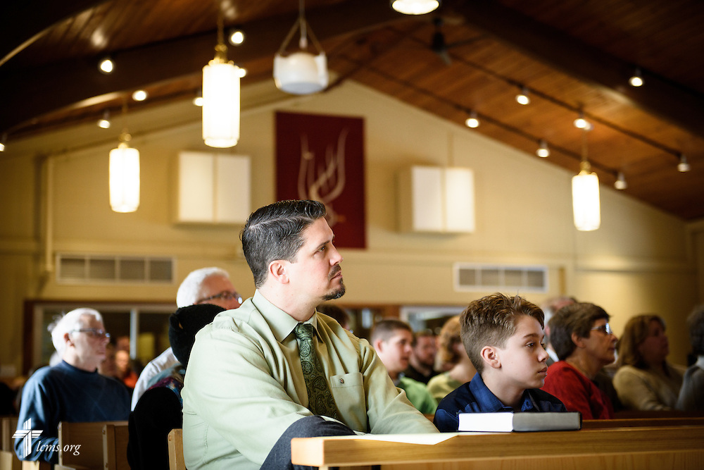 Matthew Damato and his son Bryce Damato listen during adult Bible study on Transfiguration Sunday, Feb. 7, 2016, at Peace Lutheran Church in Sussex, Wis., LCMS Communications/Erik M. Lunsford