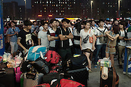 Zhengzhou, June 23rd 2013<br /> Just hired Foxconn workers are waiting for the agent who recruited them. For hiring workers, Foxconn relies on the provincial government which itself subcontract agents. The turnover is high at Foxconn and agents are almost constantly hiring.