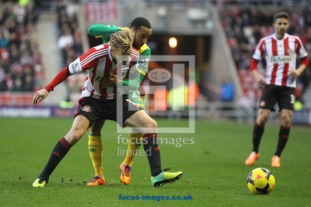 Picture by Paul Chesterton/Focus Images Ltd +44 7904 640267<br /> 21/12/2013<br /> Nathan Redmond of Norwich and Sunderland's Sebastian Larsson in action during the Barclays Premier League match at the Stadium Of Light, Sunderland.